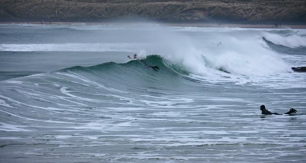 Surfing at PortBallintrae in the middle of Winter on a very murky, cold, cold day. Submitted by Amanda Killen