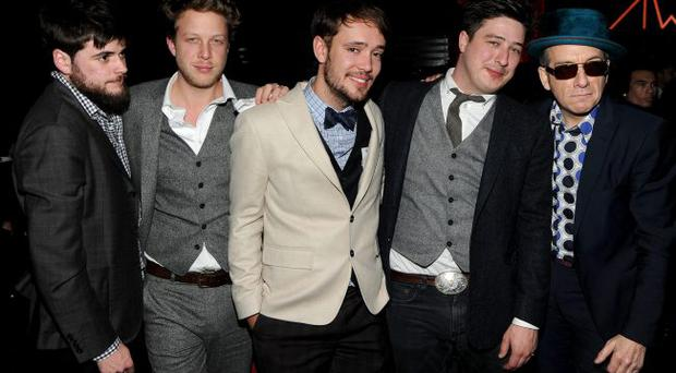 Winston Marshall, Ted Dwane, Ben Lovett, Marcus Mumford of Mumford & Sons and musician Elvis Costello attend the 54th Annual GRAMMY Awards