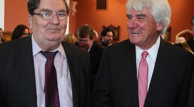 John Hume, left, with Thomas O'Neill, representing the O'Neill family, during a ceremony at the University of Ulster Magee campus in Londonderry