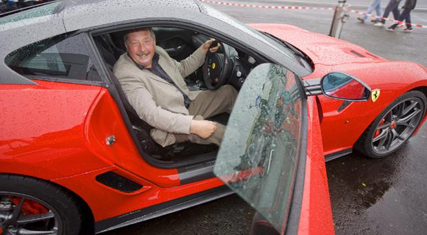 Finance Minister Sammy Wilson takes a seat in one of the supercars on show at the Ards Festival of Speed in Newtownards
