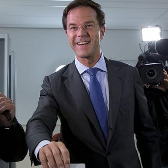 Dutch prime minister and Liberal Party leader Mark Rutte casts his vote for parliamentary elections (AP)