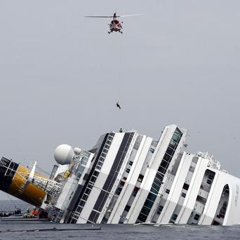 The grounded cruise ship Costa Concordia off the Tuscan island of Giglio. Experts have blamed the captain for the disaster. (AP Photo/Pier Paolo Cito)