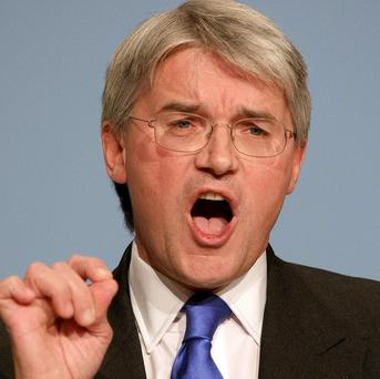 Andrew Mitchell's Department for International Development should have reacted quicker to the food crisis in the Horn of Africa, a watchdog said