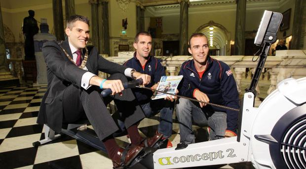 Peter and Richard Chambers put Belfast Lord Mayor Gavin Robinson through his paces at the Belfast City Marathon launch