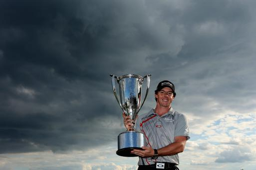 CARMEL, IN - SEPTEMBER 09: Rory McIlroy of Northern Ireland poses with his trophies after he wining the BMW Championship at Crooked Stick Golf Club on September 9, 2012 in Carmel, Indiana. (Photo by Warren Little/Getty Images)