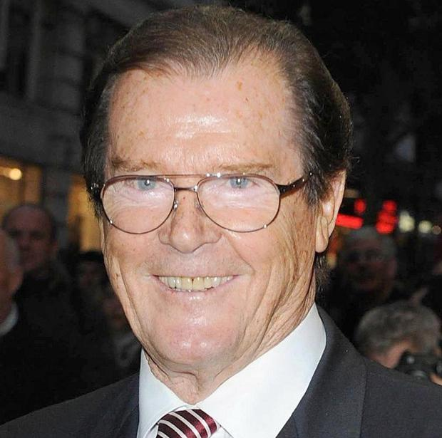 Sir Roger Moore says he ended his third marriage to wife Luisa Mattiolo over the phone
