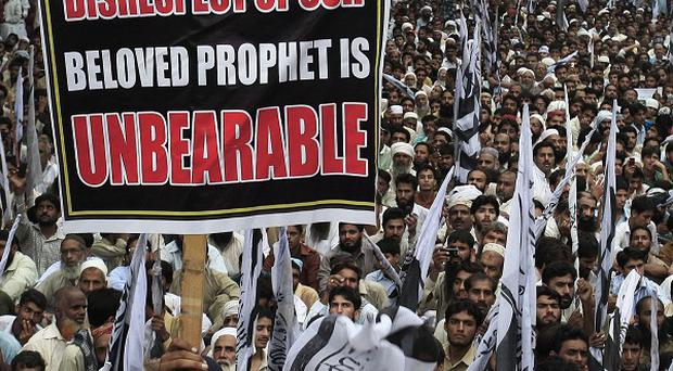 Thousands of supporters of a Pakistani religious group take part in a demonstration in Lahore, Pakistan (AP)