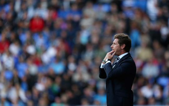 READING, ENGLAND - SEPTEMBER 16: Andre Villas-Boas, manager of Tottenham Hotspur whistles during the Barclays Premier League match between Reading and Tottenham Hotspur at Madejski Stadium on September 16, 2012 in Reading, England. (Photo by Richard Heathcote/Getty Images)