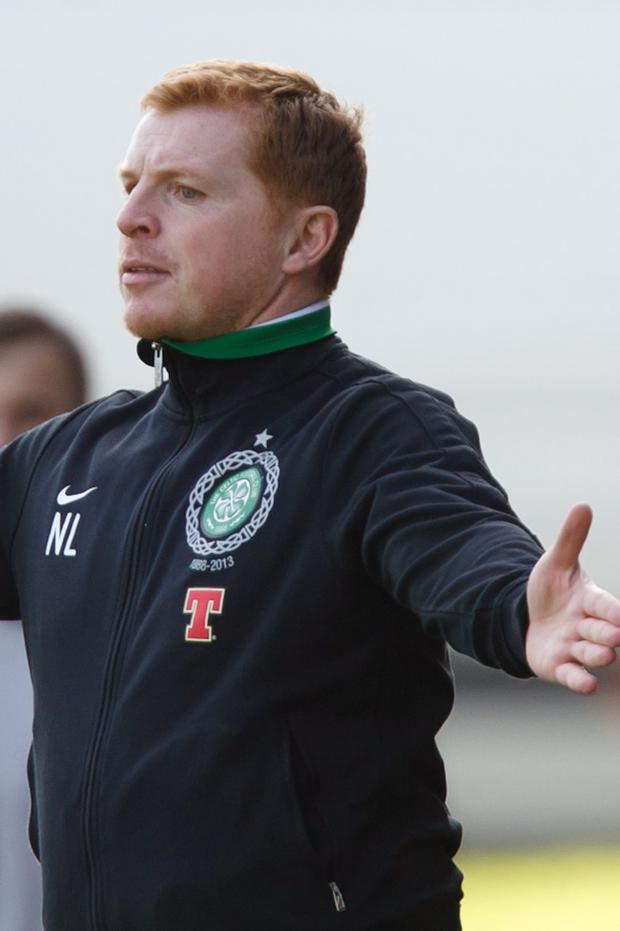 Celtic manager Neil Lennon gestures towards his players during the Clydesdale Bank Scottish Premier League match at McDiarmid Park, Perth