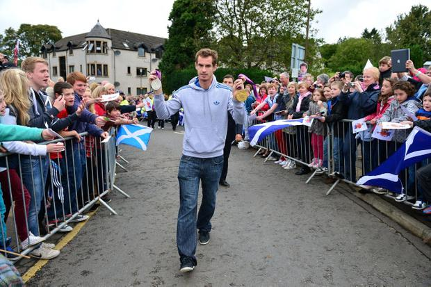 DUNBLANE, SCOTLAND - SEPTEMBER 16: Tennis player Andy Murray returns to Dunblane following his win in the US Open and his gold medal in the 2012 Olympic games in London, on September 16, 2012 in Dunblane,Scotland. Thousands lined the streets of his hometown as the 25 year old returned to meet with family and friends following his summer triumphs. (Photo by Jeff J Mitchell/Getty Images)