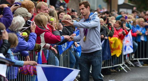 DUNBLANE, SCOTLAND - SEPTEMBER 16: Tennis player Andy Murray returns to Dunblane following his win in the US Open and his gold medal in the 2012 Olympic games in London, on September 16, 2012 in Dunblane, Scotland. Thousands lined the streets of his hometown as the 25 year old returned to meet with family and friends following his summer triumphs. (Photo by Jeff J Mitchell/Getty Images)