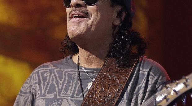 Carlos Santana will tell his story in a new book