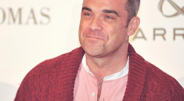 Robbie Williams is set to become a dad