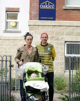 Natasha Moore and Tracey O'Donoghue outside Oaklee Housing Association on the Falls Road