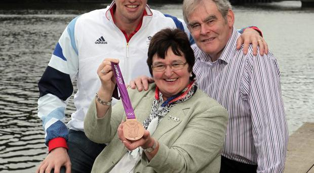 Volunteers: Jennifer and William Campbell with their son Alan, Olympic rowing bronze medal winner