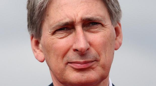 Philip Hammond says UK military operations in Afghanistan will continue 'substantially unchanged'