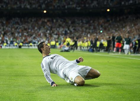 MADRID, SPAIN - SEPTEMBER 18: Cristiano Ronaldo of Real Madrid celebrates scoring his sides winning goal during the UEFA Champions League group D match between Real Madrid and Manchester City FC at the Estadio Santiago Bernabeu on September 18, 2012 in Madrid, Spain. (Photo by Jasper Juinen/Getty Images)