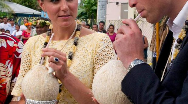 The Queen's coconuts: Prince William, Duke of Cambridge and Catherine, Duchess of Cambridge drink from a lovely pair of coconuts which were picked from a tree planted by the Queen in 1982 on September 18, 2012 in Tuvalu. 2012 Getty Images