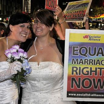 Two women show their support for same-sex marriages in Sydney, Australia (AP)