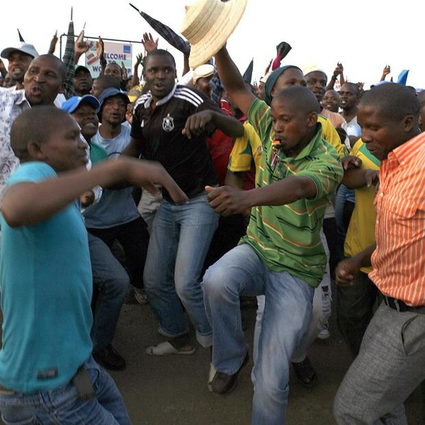 South African miners celebrate the end of the Lonmin strike (AP)