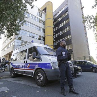 Police guard the offices of a French magazine which published cartoons of the Prophet Mohammed (AP)