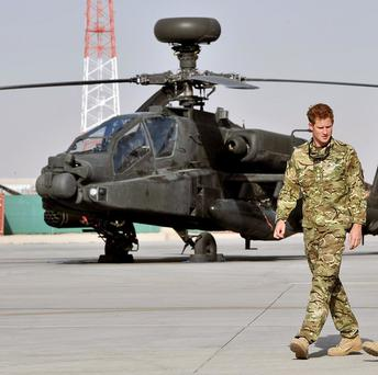 Prince Harry, left, is currently stationed at Camp Bastion in Afghanistan