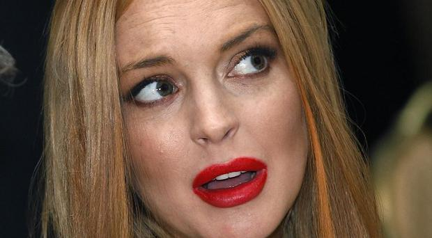 Lindsay Lohan was arrested in relation to an incident involving her car