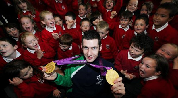 Michael McKillop at his old school St MacNissi's showing off his medals to the pupils