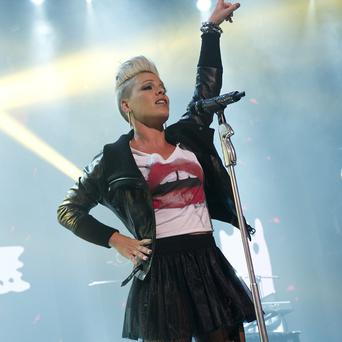 Pink reckons she would be pregnant again if she wasn't touring