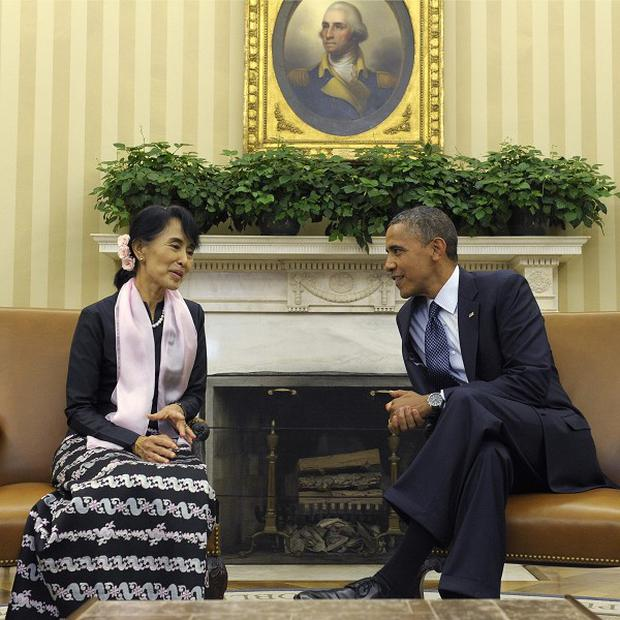 US President Barack Obama meets with Burmese democracy leader Aung San Suu Kyi in the Oval Office of the White House (AP)