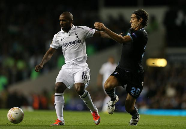 Lazio's Giuseppe Biava (right) and Tottenham Hotspur's Jermain Defoe battle for the ball during the Europa League, Group J match at White Hart Lane, London