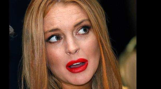 Lindsay Lohan's publicist says the injury claims are false