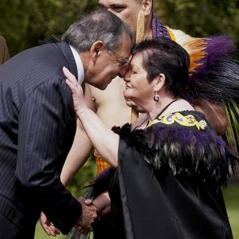 US Defence Secretary Leon Panetta, left, receives a 'hongi', a traditional welcome of pressing noses together, during a Maori welcoming ceremony (AP)