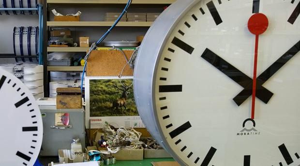 A Swiss railway station clock being produced at the Mobatime Swiss Inc factory in Sumiswald, Switzerland (AP Photo/Keystone)