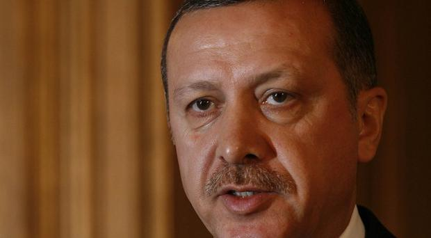 Turkish officers have been convicted of plotting to overthrow Prime Minister Recep Tayyip Erdogan in 2003.