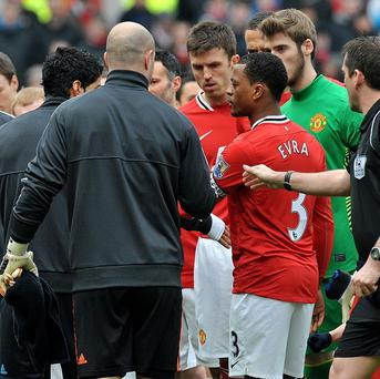 Luis Suarez refuses to shake the hand of Manchester United's Patrice Evra last season