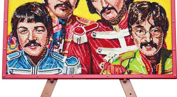 Portrait of the Beatles made from jelly beans to mark the opening of the West End show Let It Be (Jelly Belly/PA)