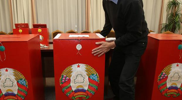 An election commission official sets up ballot boxes at a polling station in Minsk, Belarus (AP)