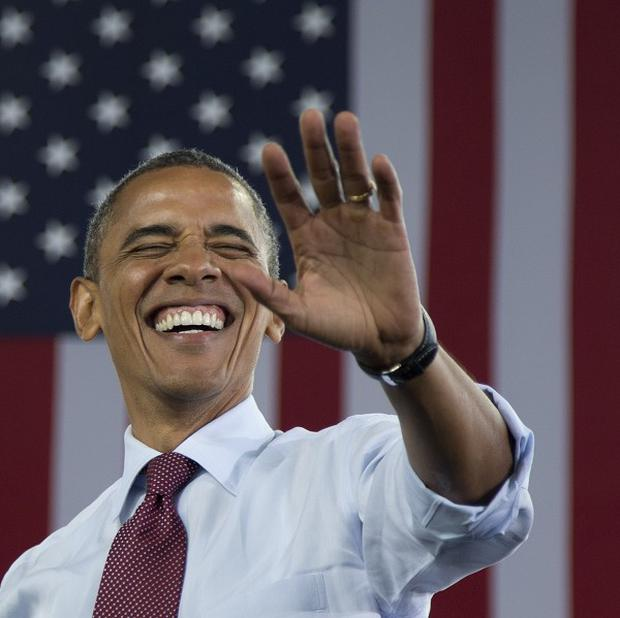 President Barack Obama waves to the crowd as he arrives at a campaign event in Milwaukee (AP)