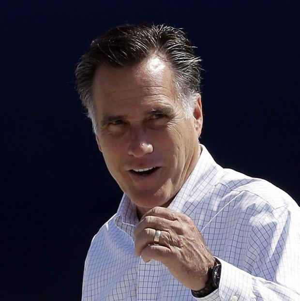 Republican presidential candidate Mitt Romney gets ready to board his campaign plane in Los Angeles (AP)