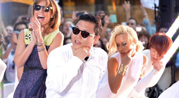 NEW YORK, NY - SEPTEMBER 14: Journalist and Savannah Guthrie (L) and South Korean rapper Psy performs on NBC's