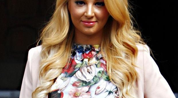 Tulisa Contostavlos has revealed her involvement in a girl gang that took part in criminal activity