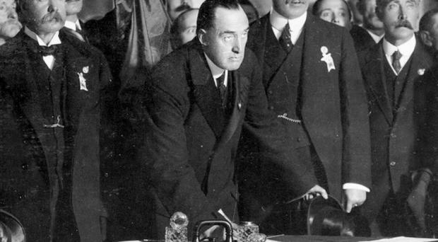Sir Edward Carson puts the first signature on the Ulster Covenant at Belfast City Hall in 1912