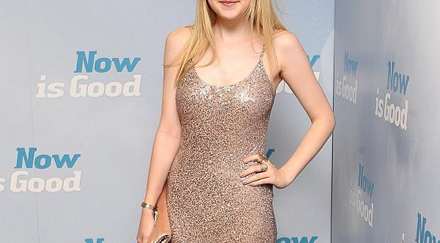 Dakota Fanning said she likes watching her old movies