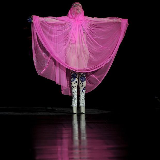 Lady Gaga concealed her fuller figure on the catwalk at London Fashion Week