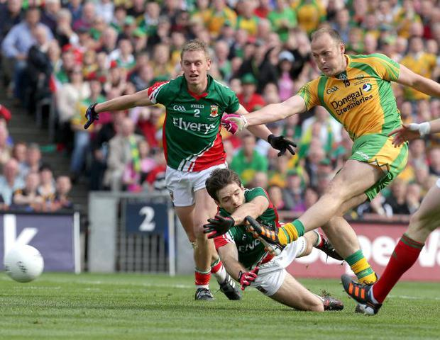 Net gain: Donegal's Colm McFadden scores an early goal which put his side seven points up