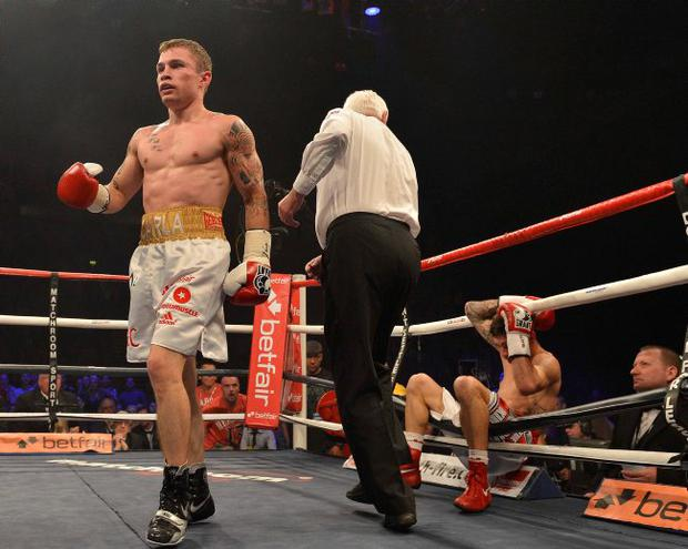 No mercy: Carl Frampton leaves Steve Molitor helpless on the ropes during the Belfast boxer's Odyssey victory