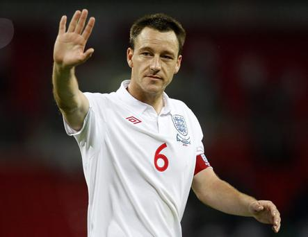 Exit: John Terry's retirement from international football preceded an FA hearing over allegations he racially abused Anton Ferdinand