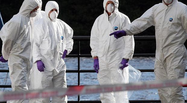 Forensic officers at the scene outside the main council offices, beside the River Foyle, in Londonderry