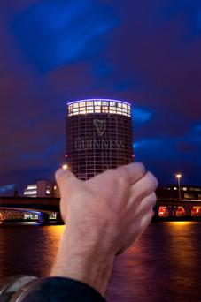 The Obel tower on the Belfast's waterfront has been transformed into a pint of stout